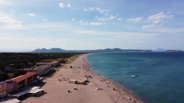 Aerial View Of People Relaxing and Sunbathing On Sandy Shore Of Platja de Illa Roja In Begur, Girona, Spain.