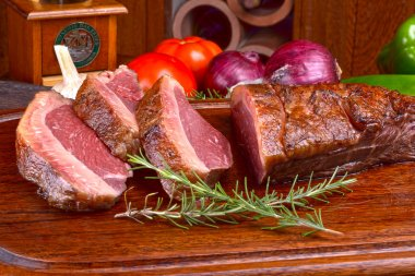 Roast picanha on wooden board
