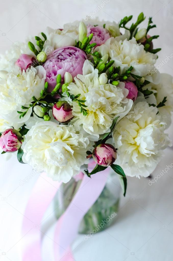 Bride bouquet of wedding flowers pink peony in vase on white ...
