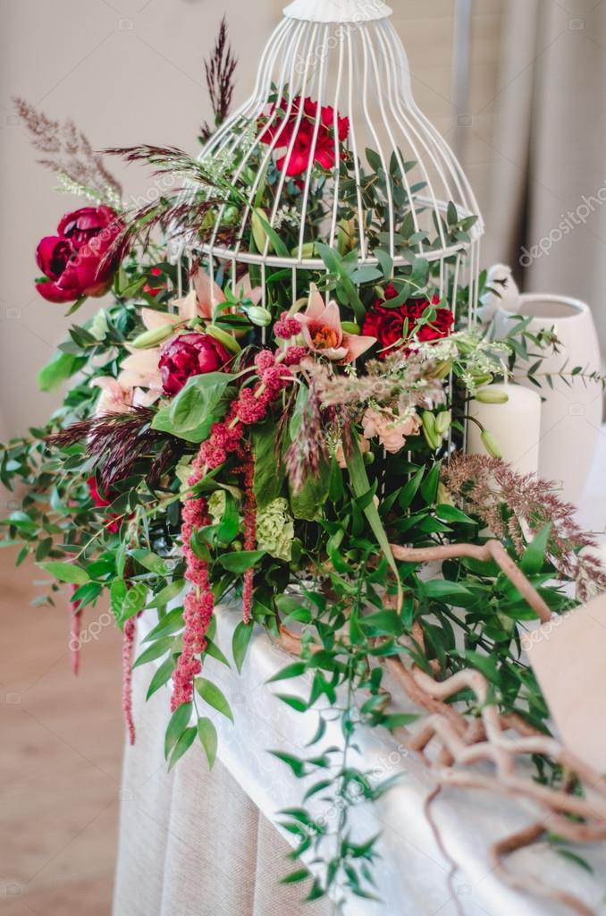 Wedding ceremony decoration in restoraunt. The composition of red ...