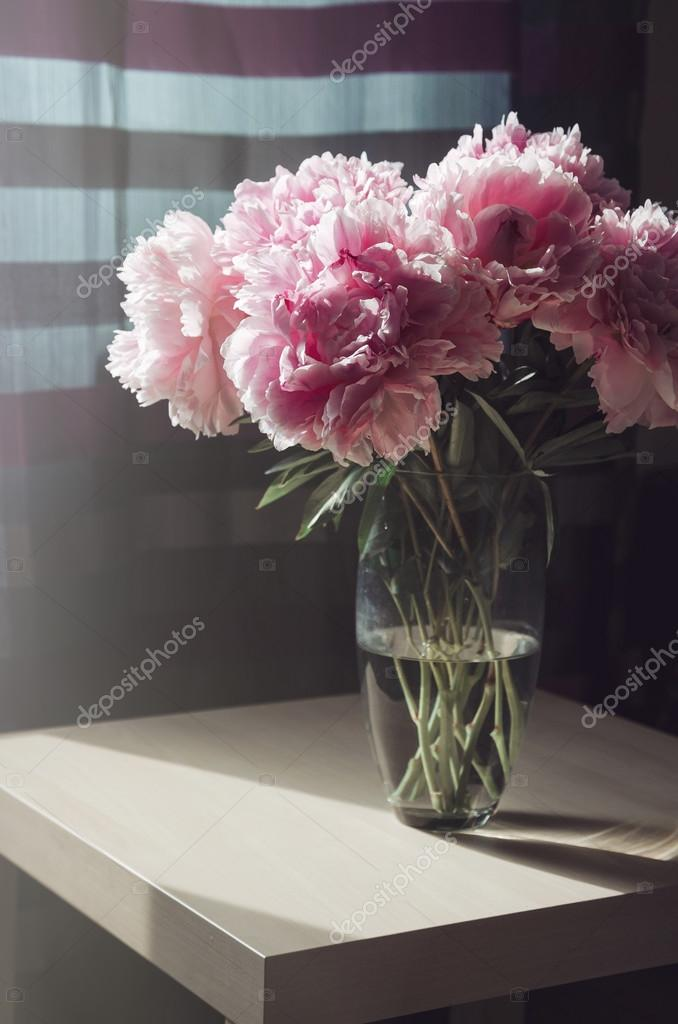 Beautiful fresh bouquet of pink peonies roses flowers in glass vase on the table with sunlight ... & Beautiful fresh bouquet of pink peonies roses flowers in glass vase ...