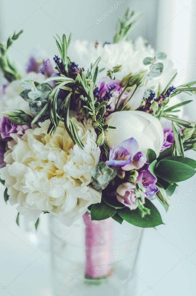 Beautiful tender wedding bouquet, white background. Bridal peony flowers with blue freesia, lilac lavender, roses. Rustic style. Holiday floristic concept. Pastel colors, soft focus.