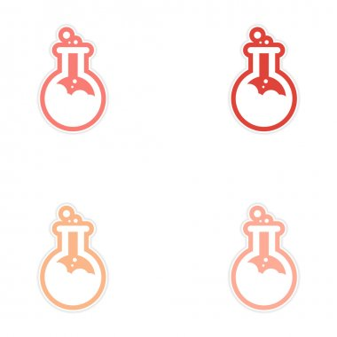 Sticker assembly flasks with liquid on a white background