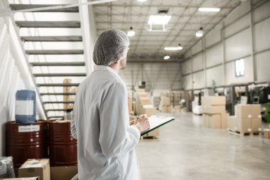 Worker In warehouse for food packaging