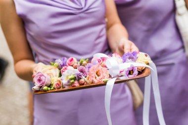 Bridesmaid holding the tray
