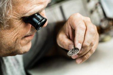 Clockmaker repairing  watch.