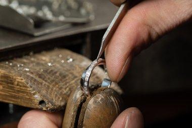 man fixing ring