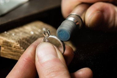 Man polishing Ring.