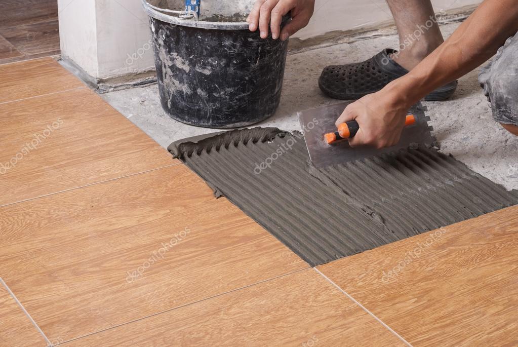Laying Tiles On The Floor Stock Photo Mkuchina 123429408
