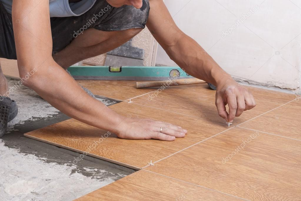 Laying Tiles On The Floor Stock Photo Mkuchina 123429426