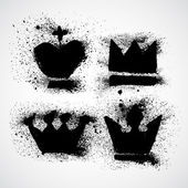 Fotografie Grunge Royal crowns set with splashes