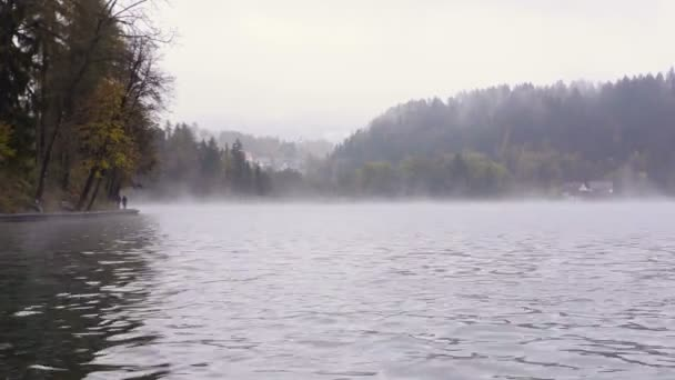 Bled lake. View of the village. Fog