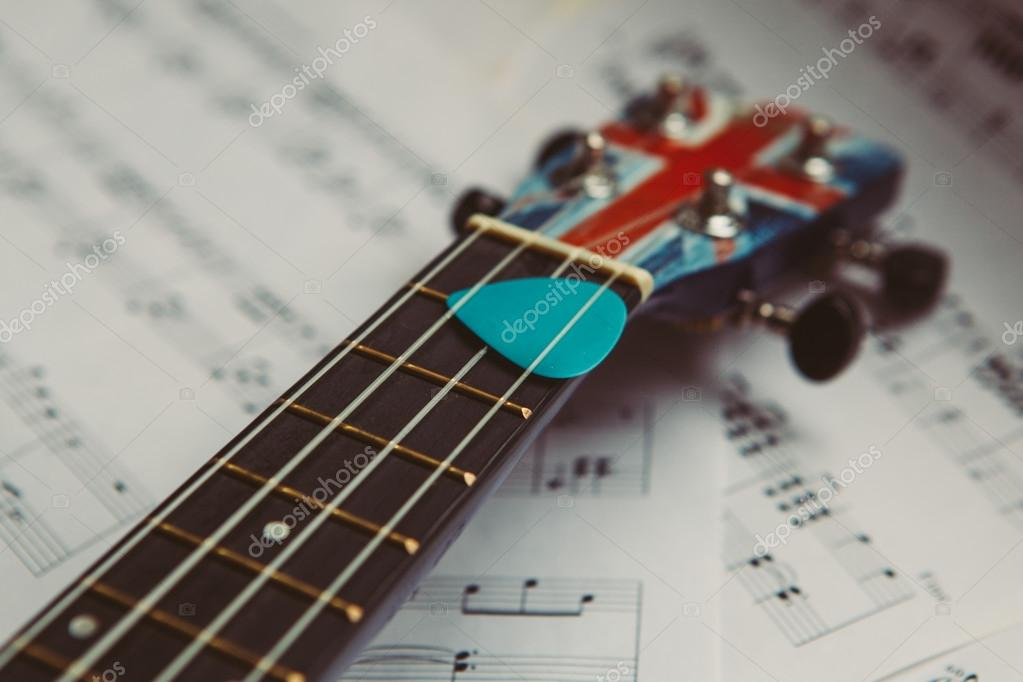Ukulele and music notes sheet