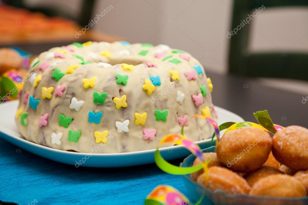 Birthday Cake On A Blue Table Cloth Stock Image