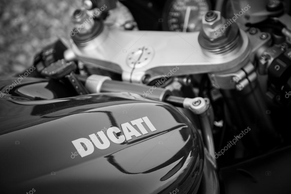 Red ducati motorcycle 996s. Reservoir sign, black and white photo.