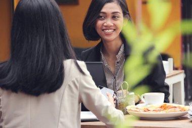 Businesswoman having conversation in a restaurant