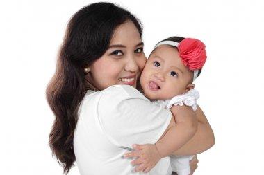 Happy mother hug her baby
