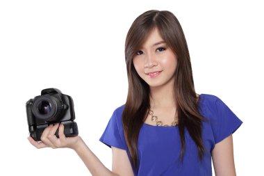 Smiling Asian girl holding camera.