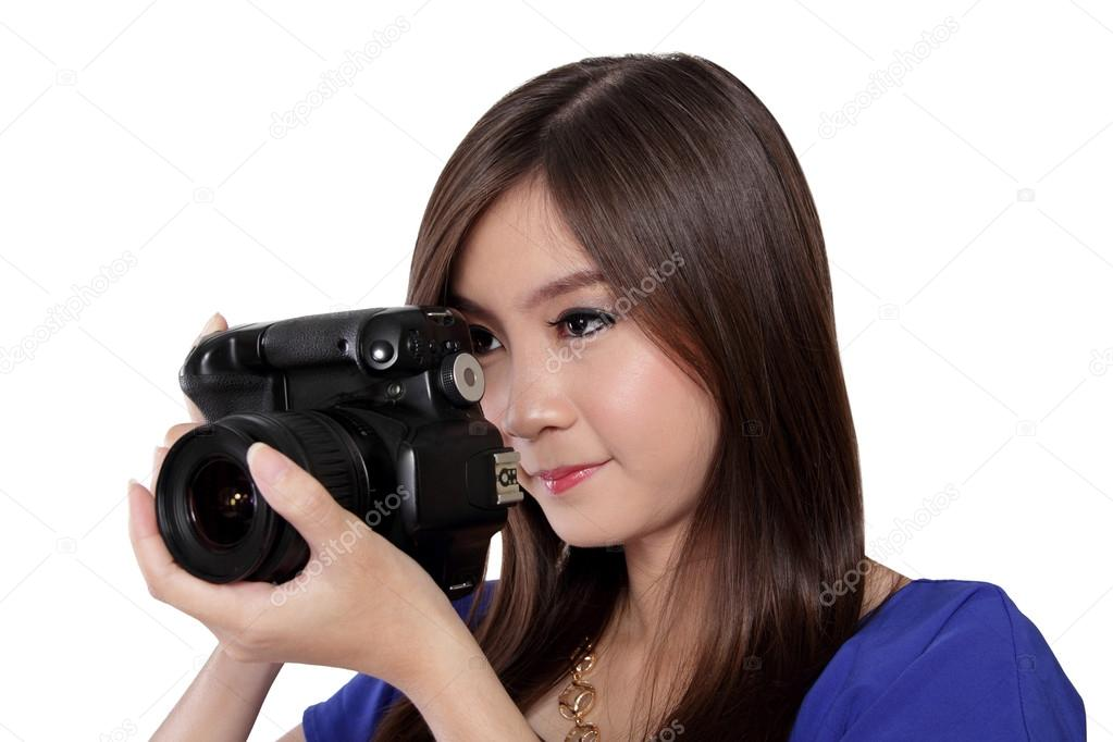 Asian girl focusing to take a picture