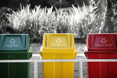 Labeled recycle bins, selective color