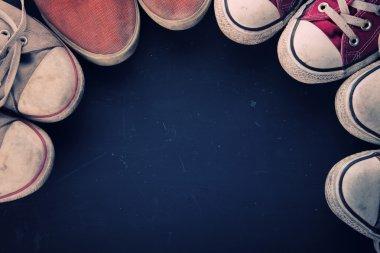Vintage canvas shoes around circular copy space