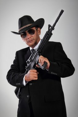 Old gangster portrait with machine gun