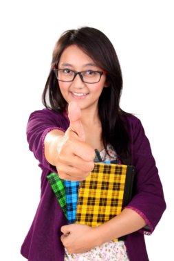School girl thumb up isolated