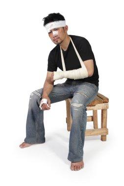Bandaged man sits and feels upset