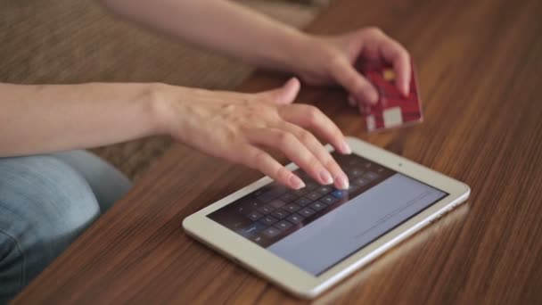 Womans hands typing security code from credit card
