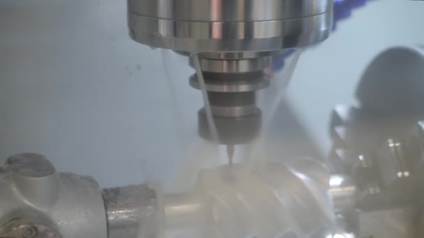 Turning milling machine with cooling system cutting metal workpiece at factory
