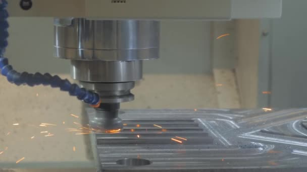 Automated turning milling machine cutting metal workpiece with sparks at factory