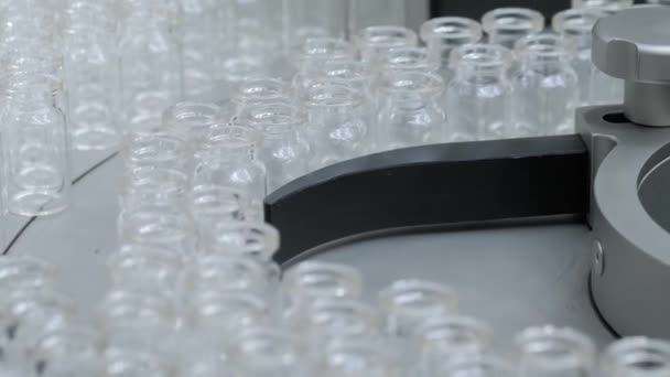 Pharmaceutical production line - conveyor belt with empty injection glass vials
