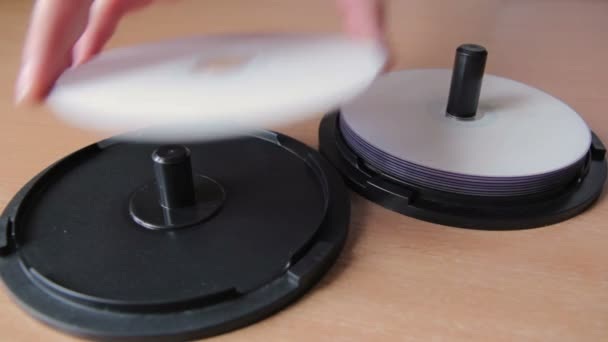 Close-up View of Woman shift a DVD