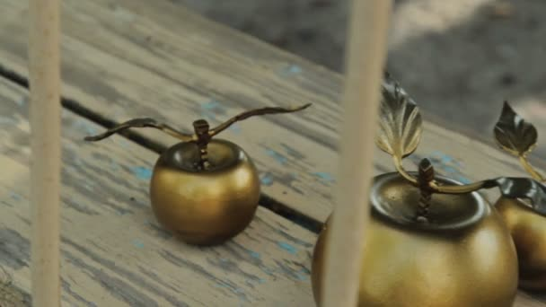 Gold forged apples, close up
