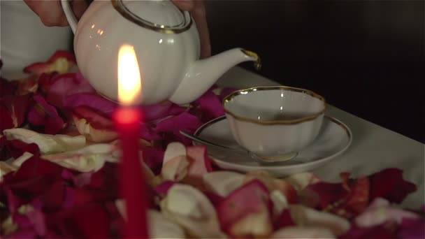 Man filling up cup with tea on romantic tea ceremony. Slow Motion