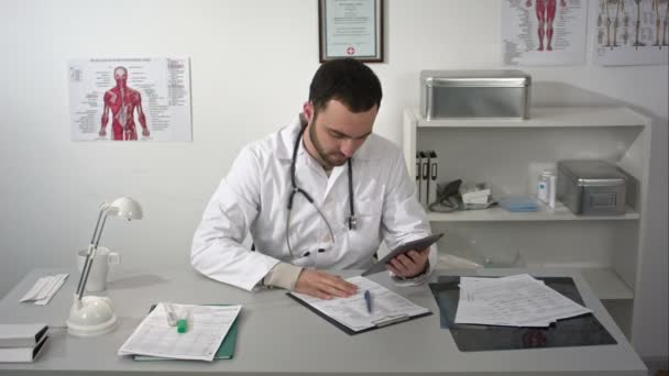 male doctor work using tablet gadget