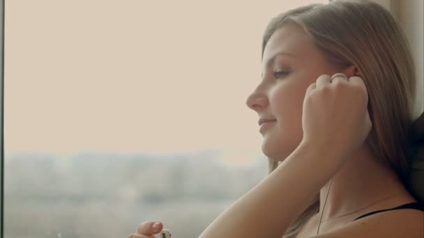 Beautiful girl listening to music with tablet at home.