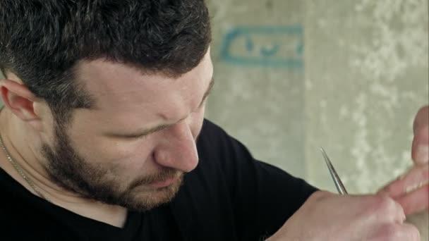 Closeup of barber making haircut.
