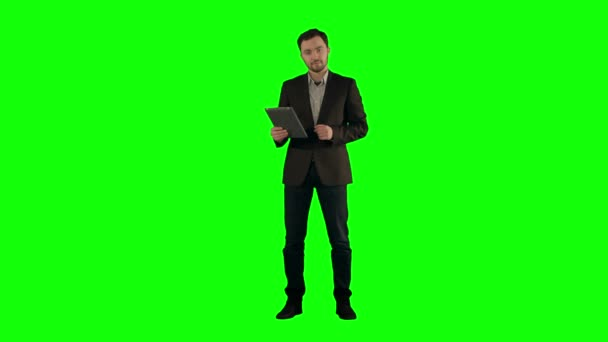 Cool businessman using electronic tablet  on a Green Screen