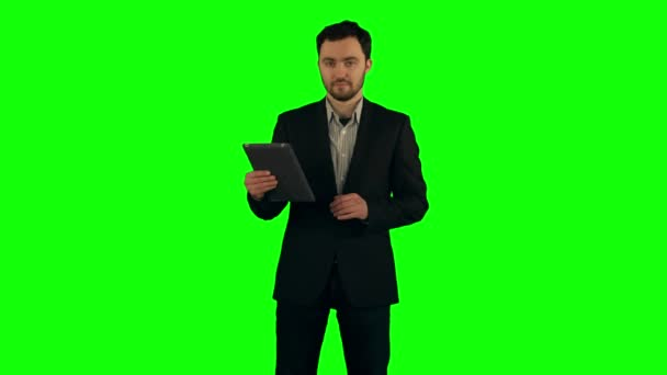 Businessman using his tablet on a Green Screen