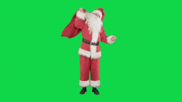 Skutečný Santa Claus nesoucí velký pytel plný dárků na klíč Chrome Green Screen