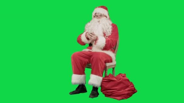 Santa claus mozgatható sejt telefon, egy zöld képernyő Chrome kulcs hívja