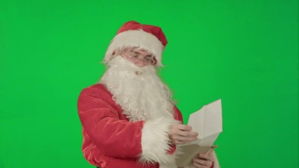 Santa Claus, a gyermekek egy zöld képernyő Chrome kulcs betűk olvasása