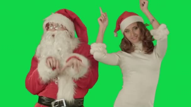 Santa claus with beautiful dancing girl on a Green Screen Chrome Key