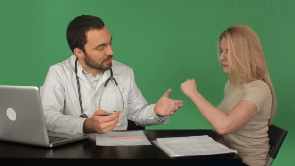 Doctor with patient measuring pulse in a hospital on a Green Screen, Chroma Key