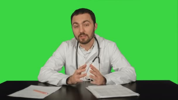 Cheerful smiling doctor with good news looking at camera on a Green Screen, Chroma Key