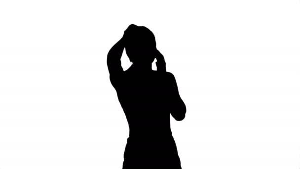 Silhouette Portrait of happy young Woman Talking On Mobile Phone ...