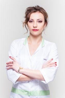 woman in a white coat isolated