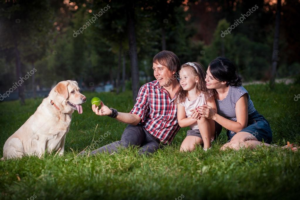 family pllaying with dog