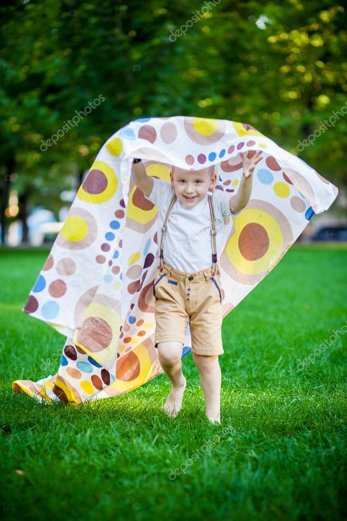 boy playing with a cape